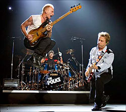 Image of The Police on stage during their reunion tour